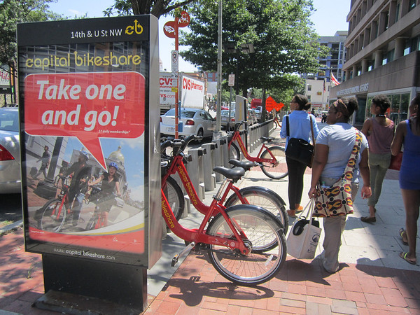 "© BIKESHARE  Imani, Age 18 Guerilla Arts  ""This photo is showing the new Capital Bikeshare stations all over the city. This station is located at 13th and U Street and you can see in this photo that these stations have been built because of gentrification in the city."""